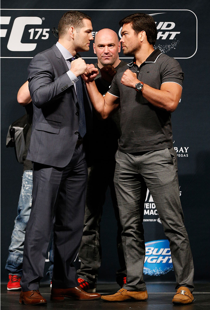 LAS VEGAS, NV - MAY 23:  (L-R) Opponents Chris Weidman and Lyoto Machida face off during the UFC press conference at the MGM Grand Garden Arena on May 23, 2014 in Las Vegas, Nevada.  (Photo by Josh Hedges/Zuffa LLC/Zuffa LLC via Getty Images)