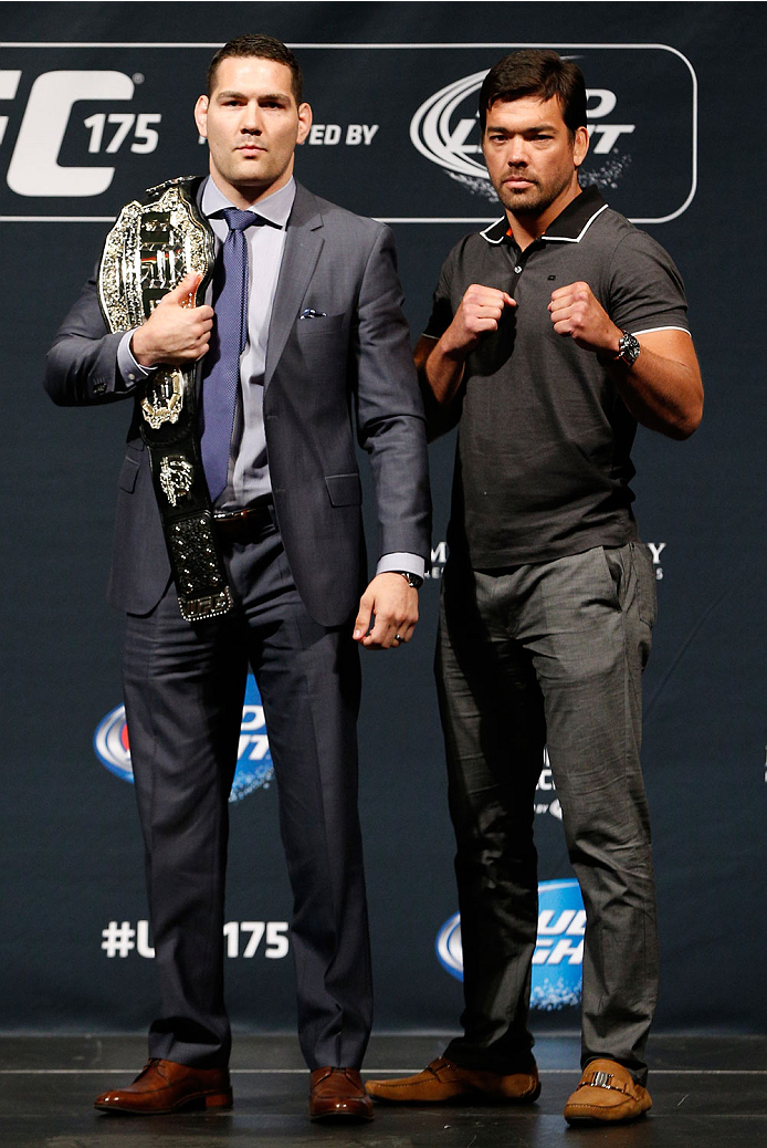 LAS VEGAS, NV - MAY 23:  (L-R) Opponents Chris Weidman and Lyoto Machida pose for photos during the UFC press conference at the MGM Grand Garden Arena on May 23, 2014 in Las Vegas, Nevada.  (Photo by Josh Hedges/Zuffa LLC/Zuffa LLC via Getty Images)