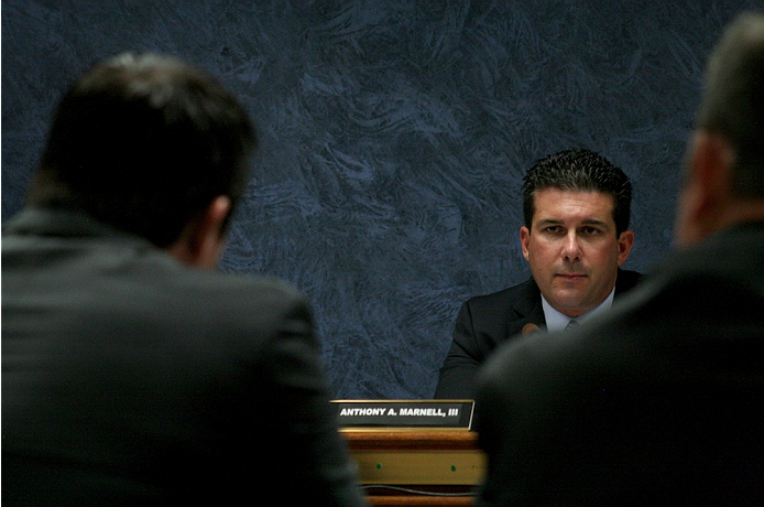 Former UFC middleweight Chael Sonnen listens to commissioner Anthony Marnell during his hearing on July 23, 2014. Sonnen was suspended two years from competing in Las Vegas or anywhere else by the NSAC for his admitted use of banned substances earlier in 2014.