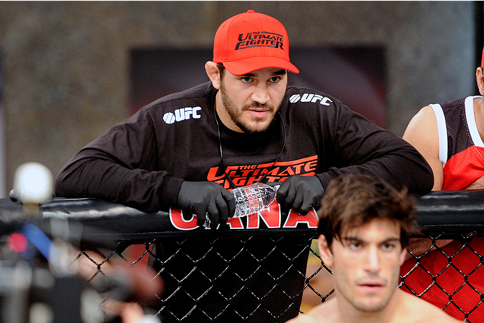 LACHUTE, CANADA - NOVEMBER 5:  Team Canada Coach Patrick Cote stands above fighter Elias Theodorou before his middleweight bout against Team Australia fighter Zein Saliba during filming of The Ultimate Fighter Nations television series on November 5, 2013 in Lachute, Quebec, Canada. (Photo by Richard Wolowicz/Zuffa LLC/Zuffa LLC via Getty Images) *** Local Caption *** Elias Theodorou; Patrick Cote