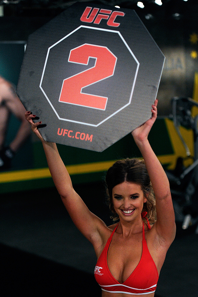 LACHUTE, CANADA - NOVEMBER 5:  UFC Octagon Girl Kahili Blundell signals the start of round two between Team Canada fighter Elias Theodorou and Team Australia fighter Zein Saliba in their middleweight bout during filming of The Ultimate Fighter Nations television series on November 5, 2013 in Lachute, Quebec, Canada. (Photo by Richard Wolowicz/Zuffa LLC/Zuffa LLC via Getty Images) *** Local Caption *** Kahili Blundell