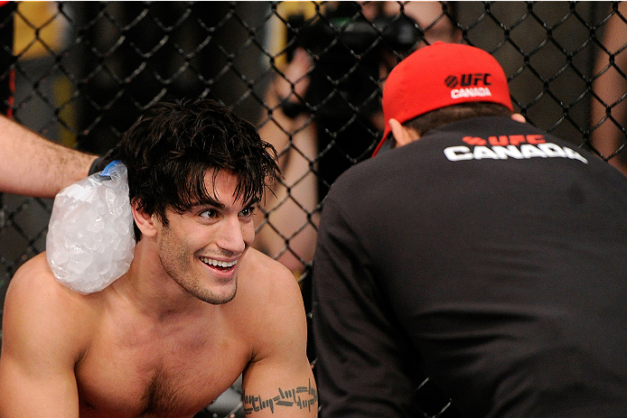 LACHUTE, CANADA - NOVEMBER 5:  Team Canada fighter Elias Theodorou smiles in between rounds during his middleweight bout against Team Australia fighter Zein Saliba during filming of The Ultimate Fighter Nations television series on November 5, 2013 in Lachute, Quebec, Canada. (Photo by Richard Wolowicz/Zuffa LLC/Zuffa LLC via Getty Images) *** Local Caption *** Elias Theodorou