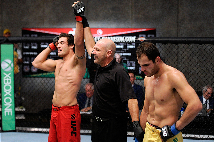 LACHUTE, CANADA - NOVEMBER 5:  (L-R) Team Canada fighter Elias Theodorou is declared the winner  by referee Yves Lavigne after his middleweight bout against Team Australia fighter Zein Saliba during filming of The Ultimate Fighter Nations television series on November 5, 2013 in Lachute, Quebec, Canada. (Photo by Richard Wolowicz/Zuffa LLC/Zuffa LLC via Getty Images) *** Local Caption *** Elias Theodorou; Zein Saliba; Yves Lavigne
