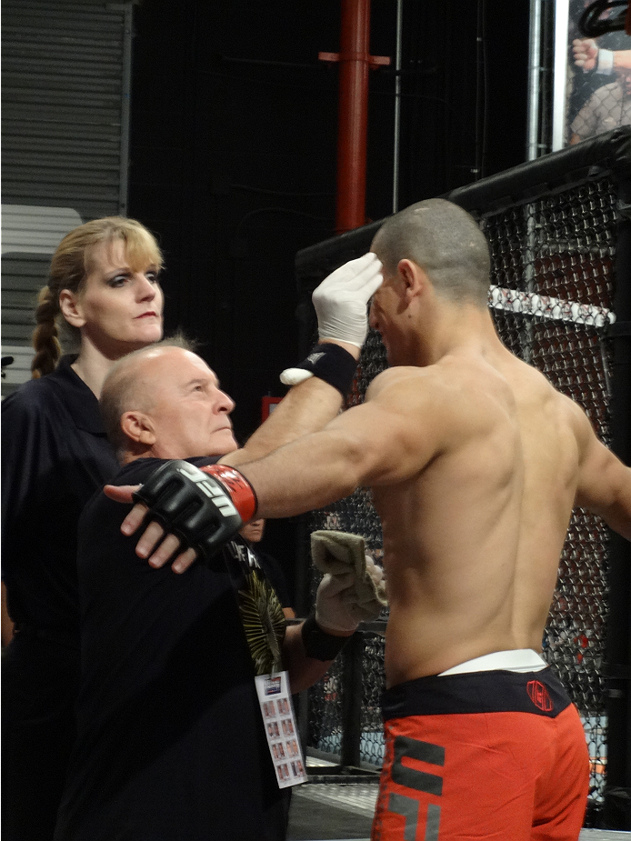 Nordine Taleb gets worked on before stepping into the Octagon.