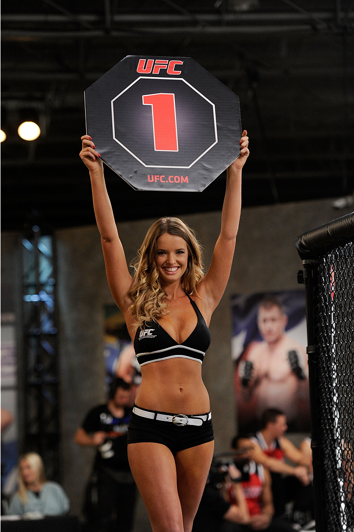 LACHUTE, CANADA - NOVEMBER 2:  UFC Octagon Girl Kahili Blundell introduces a round beforeTeam Australia fighter Brendan O'Reilly takes on Team Canada fighter Kajan Johnson in their welterweight bout during filming of The Ultimate Fighter Nations television series on November 2, 2013 in Lachute, Quebec, Canada. (Photo by Richard Wolowicz/Zuffa LLC/Zuffa LLC via Getty Images) *** Local Caption *** Kahili Blundell
