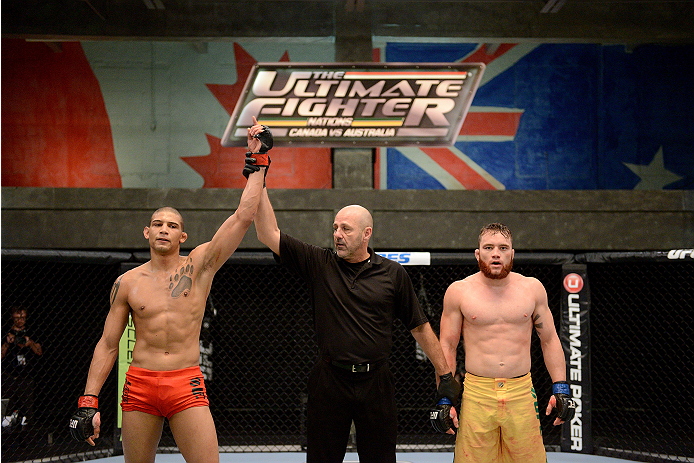 LACHUTE, CANADA - NOVEMBER 2:  (L-R) Team Canada fighter Kajan Johnson is announced the winner by referee Yves Lavigne by submission against Team Australia fighter Brendan O'Reilly in their welterweight bout during filming of The Ultimate Fighter Nations television series on November 2, 2013 in Lachute, Quebec, Canada. (Photo by Richard Wolowicz/Zuffa LLC/Zuffa LLC via Getty Images) *** Local Caption *** Brendan O'Reilly; Kajan Johnson; Yves Lavigne