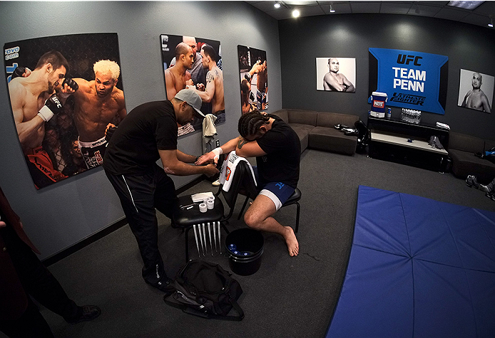 LAS VEGAS, NV - NOVEMBER 5:  Team Penn fighter Josh Clark gets his hands wrapped in the locker room before facing team Edgar fighter Corey Anderson in their preliminary fight during filming of season nineteen of The Ultimate Fighter on November 5, 2013 in Las Vegas, Nevada. (Photo by Al Powers/Zuffa LLC/Zuffa LLC via Getty Images) *** Local Caption *** Josh Clark