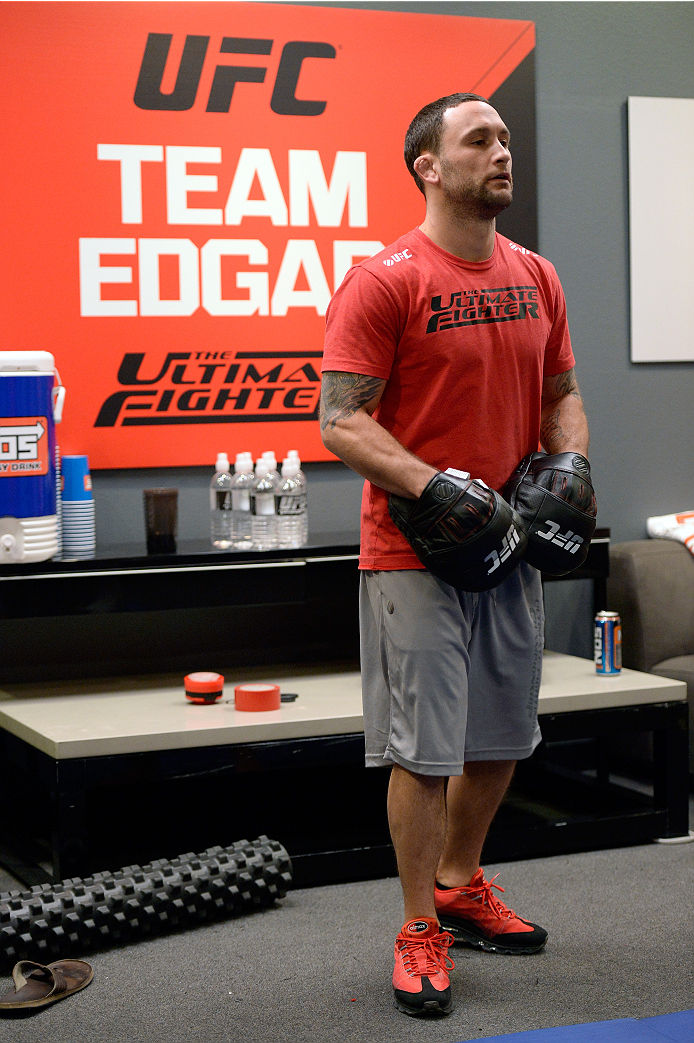 LAS VEGAS, NV - OCTOBER 24:  Coach Frankie Edgar trains his fighter Hector Urbina before facing Team Penn fighter Cathal Pendred in their preliminary fight during filming of season nineteen of The Ultimate Fighter on October 24, 2013 in Las Vegas, Nevada. (Photo by Jeff Bottari/Zuffa LLC/Zuffa LLC via Getty Images) *** Local Caption *** Frankie Edgar