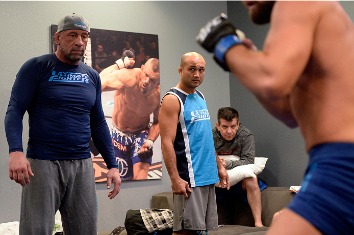 LAS VEGAS, NV - OCTOBER 24:  (L-R) Team Penn wrestling coach Mark Coleman, coach BJ Penn and jiu jitsu coach Andre Pederneiras instruct fighter Cathal Pendred before taking on Team Edgar fighter Hector Urbina in their preliminary fight during filming of season nineteen of The Ultimate Fighter on October 24, 2013 in Las Vegas, Nevada. (Photo by Jeff Bottari/Zuffa LLC/Zuffa LLC via Getty Images) *** Local Caption *** BJ Penn; Mark Coleman; Andre Pederneiras