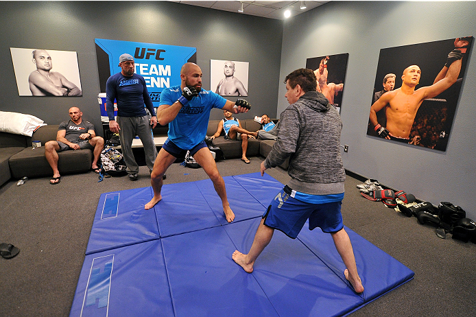 LAS VEGAS, NV - OCTOBER 24:  (L-R) Team Penn fighter Cathal Pendred warms up with jiu jitsu coach Andre Pederneiras before facing Team Edgar fighter Hector Urbina in their preliminary fight during filming of season nineteen of The Ultimate Fighter on October 24, 2013 in Las Vegas, Nevada. (Photo by Jeff Bottari/Zuffa LLC/Zuffa LLC via Getty Images) *** Local Caption *** Andre Pederneiras; Cathal Pendred