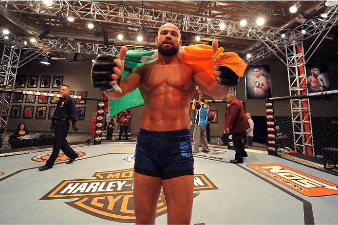 LAS VEGAS, NV - OCTOBER 24:  Team Penn fighter Cathal Pendred celebrates after defeating Team Edgar fighter Hector Urbina in their preliminary fight during filming of season nineteen of The Ultimate Fighter on October 24, 2013 in Las Vegas, Nevada. (Photo by Jeff Bottari/Zuffa LLC/Zuffa LLC via Getty Images) *** Local Caption *** Cathal Pendred