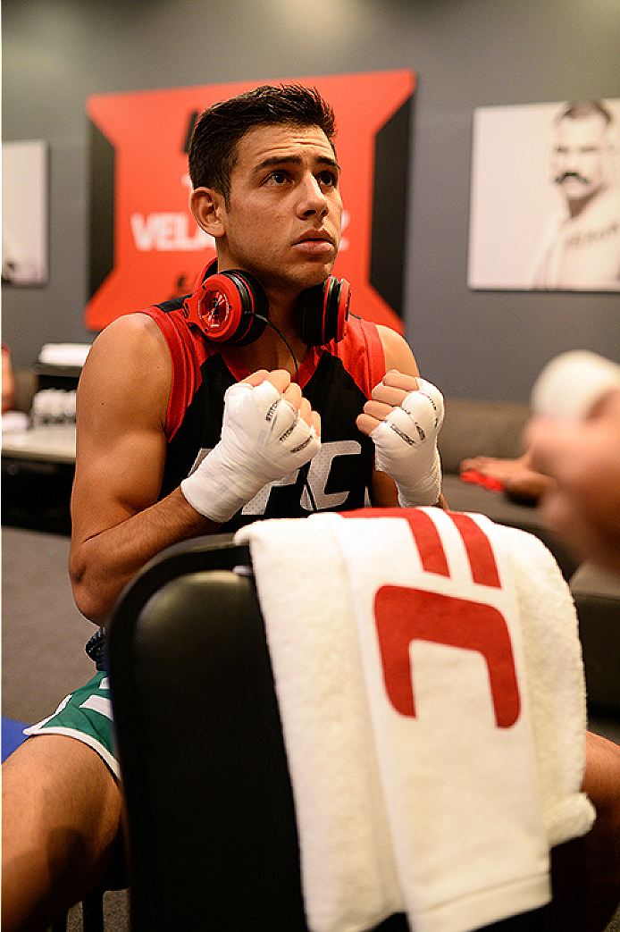 LAS VEGAS, NV - JUNE 18:  Team Velasquez fighter Yair Rodriguez gets his hands wrapped before facing team Velasquez fighter Rodolfo Rubio in their semifinal fight during filming of The Ultimate Fighter Latin America on June 18, 2014 in Las Vegas, Nevada. (Photo by Al Powers/Zuffa LLC/Zuffa LLC via Getty Images) *** Local Caption ***Yair Rodriguez