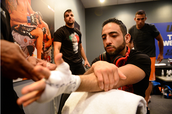 LAS VEGAS, NV - JUNE 18:  Team Velasquez fighter Rodolfo Rubio gets his hands wrapped before facing team Velasquez fighter Yair Rodriguez in their semifinal fight during filming of The Ultimate Fighter Latin America on June 18, 2014 in Las Vegas, Nevada. (Photo by Al Powers/Zuffa LLC/Zuffa LLC via Getty Images) *** Local Caption ***Rodolfo Rubio