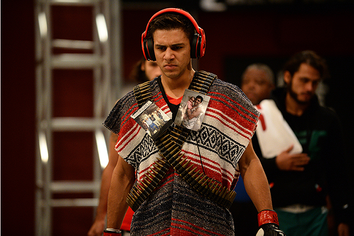 LAS VEGAS, NV - JUNE 18:  Team Velasquez fighter Yair Rodriguez prepares to enter the Octagon before facing team Velasquez fighter Rodolfo Rubio in their semifinal fight during filming of The Ultimate Fighter Latin America on June 18, 2014 in Las Vegas, Nevada. (Photo by Al Powers/Zuffa LLC/Zuffa LLC via Getty Images) *** Local Caption ***Yair Rodriguez