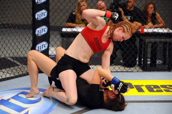 LAS VEGAS, NV - MAY 29:  Peggy Morgan (top) punches Bethany Marshall in their elimination fight during filming of season eighteen of The Ultimate Fighter on May 29, 2013 in Las Vegas, Nevada. (Photo by Al Powers/Zuffa LLC/Zuffa LLC via Getty Images)