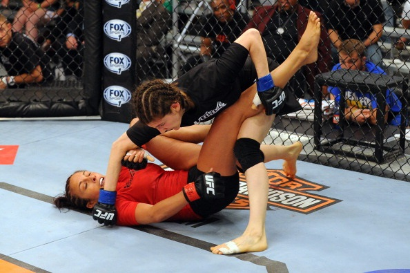LAS VEGAS, NV - MAY 29:  Roxanne Modafferi (R) punches Valeri Letourneau in their elimination fight during filming of season eighteen of The Ultimate Fighter on May 29, 2013 in Las Vegas, Nevada. (Photo by Al Powers/Zuffa LLC/Zuffa LLC via Getty Images)