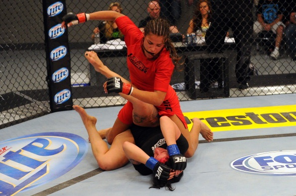 LAS VEGAS, NV - MAY 29:  Julianna Pena (top) punches Gina Mazany in their elimination fight during filming of season eighteen of The Ultimate Fighter on May 29, 2013 in Las Vegas, Nevada. (Photo by Al Powers/Zuffa LLC/Zuffa LLC via Getty Images)