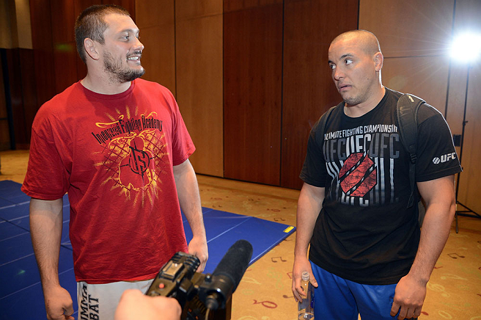 LAS VEGAS, NV - DECEMBER 13:  UFC fighters Matt Mitrione (L) and Pat Barry speak to the media during the Ultimate Fighter 16 Finale open workouts at The Joint at the Hard Rock Hotel and Casino on December 13, 2012 in Las Vegas, Nevada.  (Photo by Jeff Bottari/Zuffa LLC/Zuffa LLC)