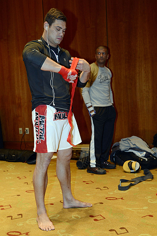 LAS VEGAS, NV - DECEMBER 13: UFC fighter Shane Del Rosario wraps his hands before working out for the media during the Ultimate Fighter 16 Finale open workouts at The Joint at the Hard Rock Hotel and Casino on December 13, 2012 in Las Vegas, Nevada.  (Photo by Jeff Bottari/Zuffa LLC/Zuffa LLC)
