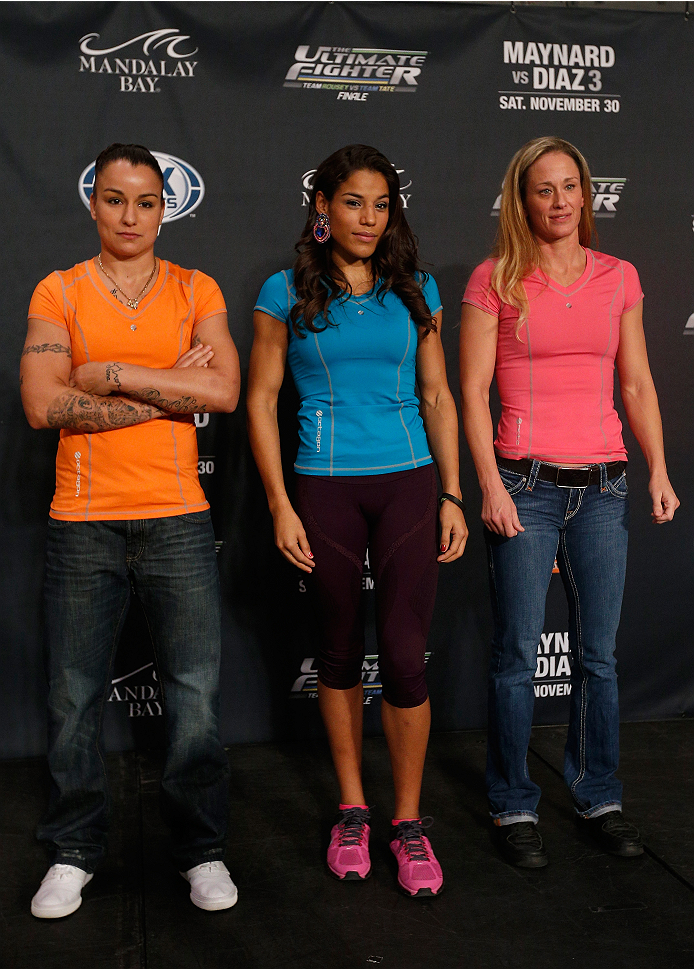 LAS VEGAS, NV - NOVEMBER 27:  (L-R) The Ultimate Fighter women's bantamweight contenders Raquel Pennington, Julianna Pena, and Jessica Rakoczy pose for a photo during media day ahead of The Ultimate Fighter season 18 live finale inside the Mandalay Bay Events Center on November 27, 2013 in Las Vegas, Nevada. (Photo by Josh Hedges/Zuffa LLC/Zuffa LLC via Getty Images)