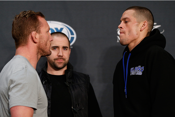 LAS VEGAS, NV - NOVEMBER 27:  (L-R) Opponents Gray Maynard and Nate Diaz face off during media day ahead of The Ultimate Fighter season 18 live finale inside the Mandalay Bay Events Center on November 27, 2013 in Las Vegas, Nevada. (Photo by Josh Hedges/Zuffa LLC/Zuffa LLC via Getty Images)