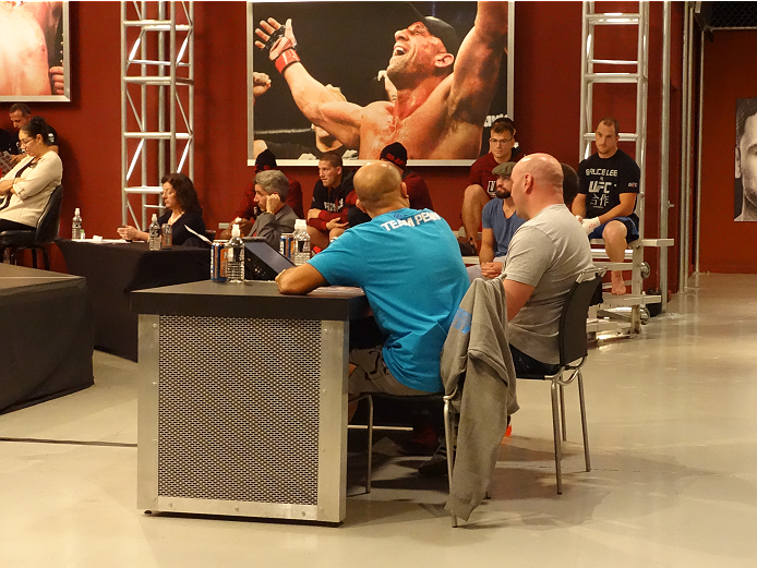 Ultimate Fighter coach BJ Penn and UFC president Dana White take in the TUF 19 elimination fights.
