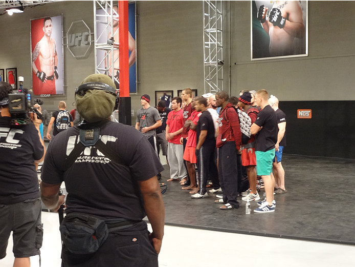 All 16 Ultimate Fighter 19 contestants wait to be picked by Team Penn or Team Edgar.