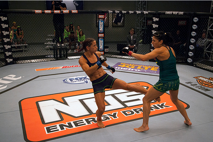 LAS VEGAS, NV - JULY 8:  Team Melendez fighter Tecia Torres kicks team Pettis fighter Randa Markos during filming of season twenty of The Ultimate Fighter on July 8, 2014 in Las Vegas, Nevada. (Photo by Brandon Magnus/Zuffa LLC/Zuffa LLC via Getty Images) *** Local Caption *** Randa Markos;Tecia Torres