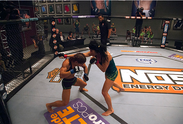 LAS VEGAS, NV - JULY 8:  Team Pettis fighter Randa Markos punches team Melendez fighter Tecia Torres during filming of season twenty of The Ultimate Fighter on July 8, 2014 in Las Vegas, Nevada. (Photo by Brandon Magnus/Zuffa LLC/Zuffa LLC via Getty Images) *** Local Caption *** Randa Markos;Tecia Torres