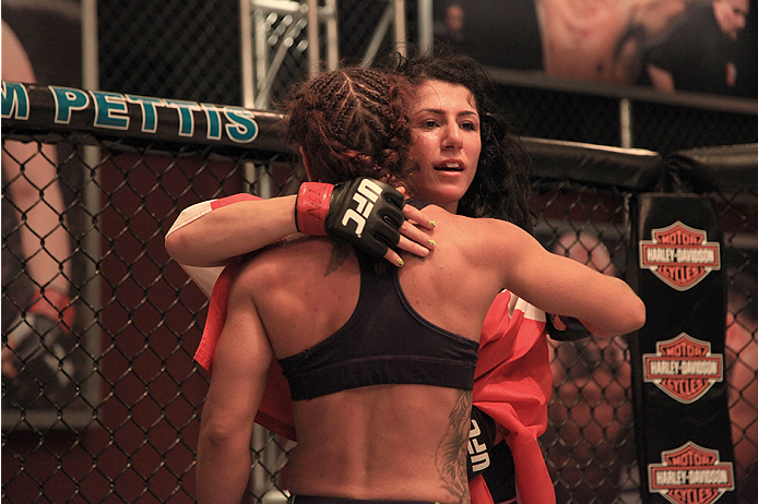 LAS VEGAS, NV - JULY 8:  Team Pettis fighter Randa Markos hugs team Melendez fighter Tecia Torres after her victory during filming of season twenty of The Ultimate Fighter on July 8, 2014 in Las Vegas, Nevada. (Photo by Brandon Magnus/Zuffa LLC/Zuffa LLC via Getty Images) *** Local Caption *** Randa Markos;Tecia Torres