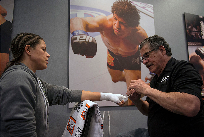 LAS VEGAS, NV - JULY 10:  Team Melendez fighter Emily Kagan gets her hands wrapped before facing team Pettis fighter Joanne Calderwood during filming of season twenty of The Ultimate Fighter on July 10, 2014 in Las Vegas, Nevada. (Photo by Brandon Magnus/Zuffa LLC/Zuffa LLC via Getty Images) *** Local Caption *** Emily Kagan
