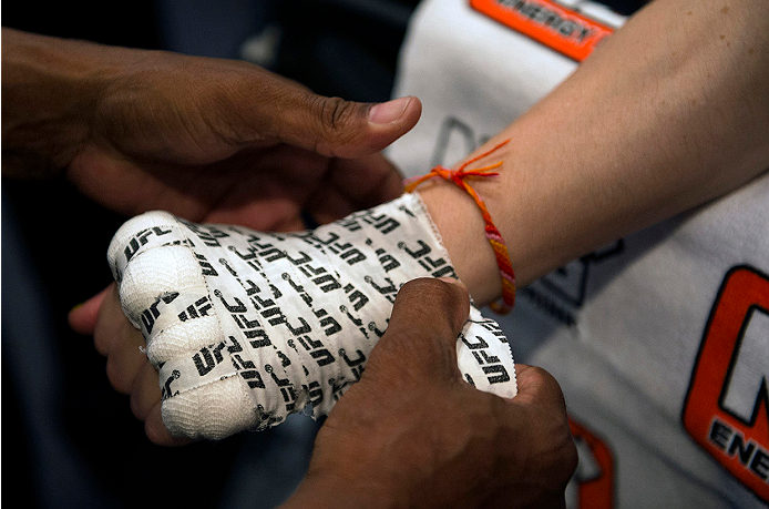 LAS VEGAS, NV - JULY 10:  Team Pettis fighter Joanne Calderwood gets her hands wrapped before facing team Melendez fighter Emily Kagan during filming of season twenty of The Ultimate Fighter on July 10, 2014 in Las Vegas, Nevada. (Photo by Brandon Magnus/Zuffa LLC/Zuffa LLC via Getty Images) *** Local Caption *** Joanne Calderwood