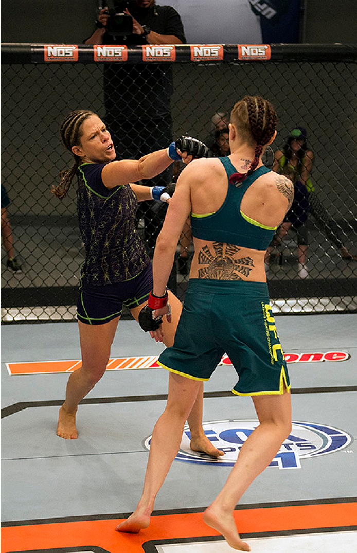 LAS VEGAS, NV - JULY 10:  (L-R) Team Melendez fighter Emily Kagan punches team Pettis fighter Joanne Calderwood during filming of season twenty of The Ultimate Fighter on July 10, 2014 in Las Vegas, Nevada. (Photo by Brandon Magnus/Zuffa LLC/Zuffa LLC via Getty Images) *** Local Caption *** Emily Kagan;Joanne Calderwood