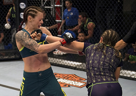 LAS VEGAS, NV - JULY 10:  (R-L) Team Melendez fighter Emily Kagan punches team Pettis fighter Joanne Calderwood during filming of season twenty of The Ultimate Fighter on July 10, 2014 in Las Vegas, Nevada. (Photo by Brandon Magnus/Zuffa LLC/Zuffa LLC via Getty Images) *** Local Caption *** Emily Kagan;Joanne Calderwood