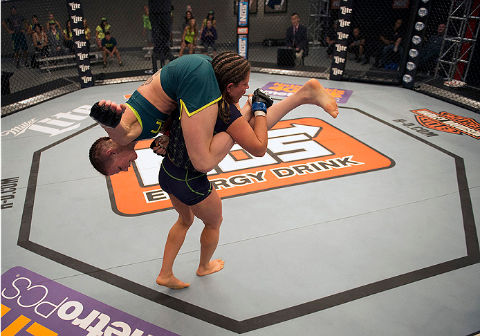 LAS VEGAS, NV - JULY 10:  Team Melendez fighter Emily Kagan lifts team Pettis fighter Joanne Calderwood during filming of season twenty of The Ultimate Fighter on July 10, 2014 in Las Vegas, Nevada. (Photo by Brandon Magnus/Zuffa LLC/Zuffa LLC via Getty Images) *** Local Caption *** Emily Kagan;Joanne Calderwood