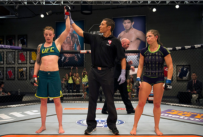 LAS VEGAS, NV - JULY 10:  Team Pettis fighter Joanne Calderwood celebrates her victory over team Melendez fighter Emily Kagan during filming of season twenty of The Ultimate Fighter on July 10, 2014 in Las Vegas, Nevada. (Photo by Brandon Magnus/Zuffa LLC/Zuffa LLC via Getty Images) *** Local Caption *** Joanne Calderwood;Emily Kagan