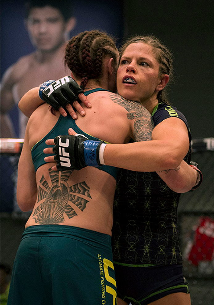 LAS VEGAS, NV - JULY 10:  (R-L) Team Melendez fighter Emily Kagan hugs team Pettis fighter Joanne Calderwood after their fight during filming of season twenty of The Ultimate Fighter on July 10, 2014 in Las Vegas, Nevada. (Photo by Brandon Magnus/Zuffa LLC/Zuffa LLC via Getty Images) *** Local Caption *** Emily Kagan;Joanne Calderwood