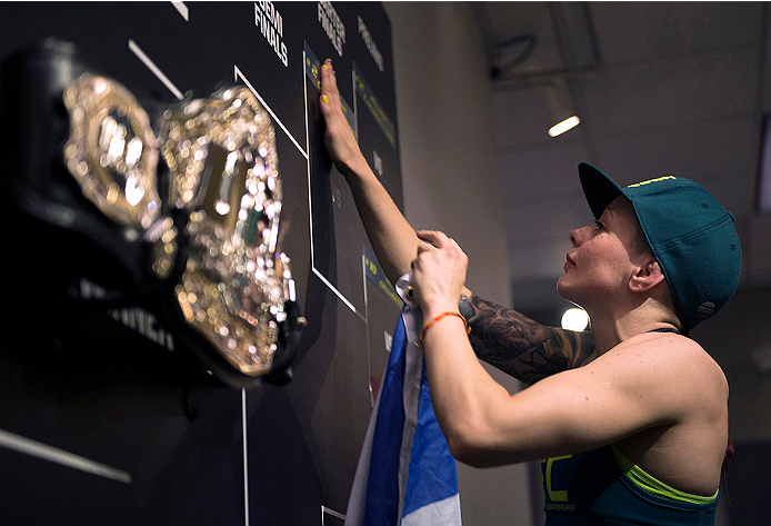 LAS VEGAS, NV - JULY 10:  Team Pettis fighter Joanne Calderwood moves her name on the bracket after defeating team Melendez fighter Emily Kagan during filming of season twenty of The Ultimate Fighter on July 10, 2014 in Las Vegas, Nevada. (Photo by Brandon Magnus/Zuffa LLC/Zuffa LLC via Getty Images) *** Local Caption *** Joanne Calderwood