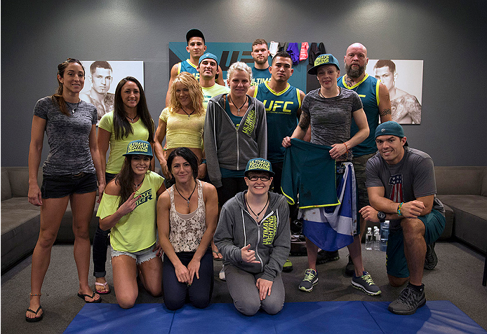 LAS VEGAS, NV - JULY 10:  Team Pettis fighter Joanne Calderwood takes a picture with her team after defeating team Melendez fighter Emily Kagan during filming of season twenty of The Ultimate Fighter on July 10, 2014 in Las Vegas, Nevada. (Photo by Brandon Magnus/Zuffa LLC/Zuffa LLC via Getty Images) *** Local Caption *** Joanne Calderwood