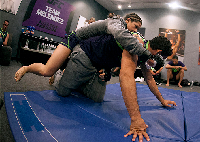 LAS VEGAS, NV - JULY 10:  Team Melendez fighter Emily Kagan warms up with Head Coach Gilbert Melendez before facing team Pettis fighter Joanne Calderwood during filming of season twenty of The Ultimate Fighter on July 10, 2014 in Las Vegas, Nevada. (Photo by Brandon Magnus/Zuffa LLC/Zuffa LLC via Getty Images) *** Local Caption *** Emily Kagan;Gilbert Melendez