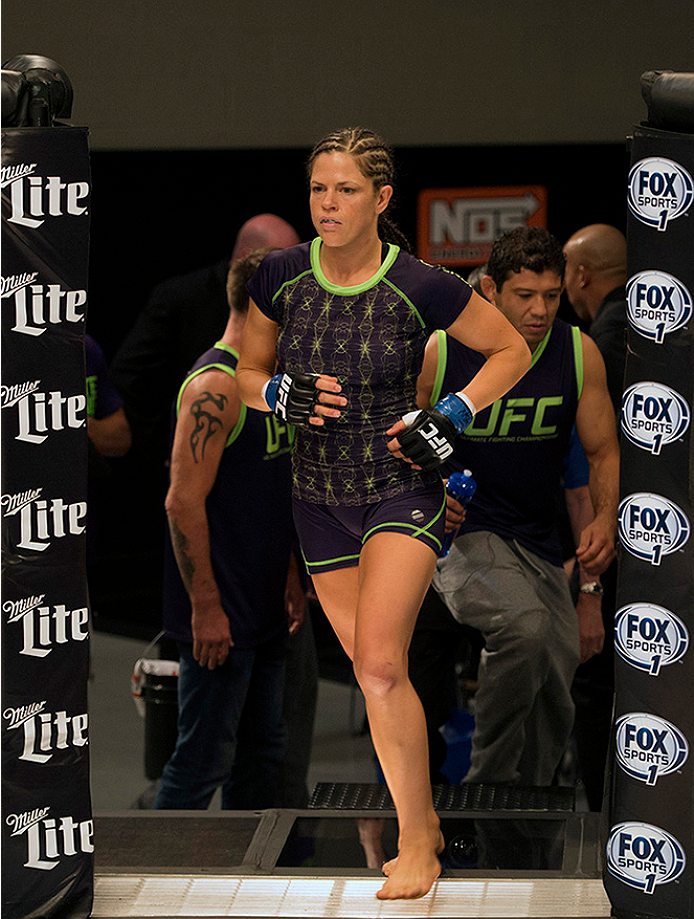 LAS VEGAS, NV - JULY 10:  Team Melendez fighter Emily Kagan enters the Octagon before facing team Pettis fighter Joanne Calderwood during filming of season twenty of The Ultimate Fighter on July 10, 2014 in Las Vegas, Nevada. (Photo by Brandon Magnus/Zuffa LLC/Zuffa LLC via Getty Images) *** Local Caption *** Emily Kagan