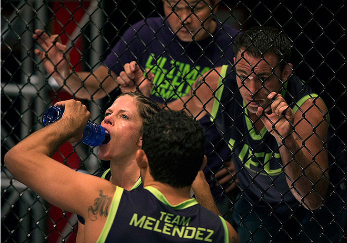 LAS VEGAS, NV - JULY 10:  Team Melendez fighter Emily Kagan gets some water and advice from her coaches in between rounds while facing team Pettis fighter Joanne Calderwood during filming of season twenty of The Ultimate Fighter on July 10, 2014 in Las Vegas, Nevada. (Photo by Brandon Magnus/Zuffa LLC/Zuffa LLC via Getty Images) *** Local Caption *** Emily Kagan