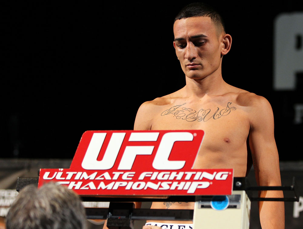 LAS VEGAS, NV - MAY 31:   Max Holloway makes weight during The Ultimate Fighter Live weigh in at the Palms Casino Resort on May 31, 2012 in Las Vegas, Nevada.  (Photo by Josh Hedges/Zuffa LLC/Zuffa LLC via Getty Images)  *** Local Caption *** Max Holloway