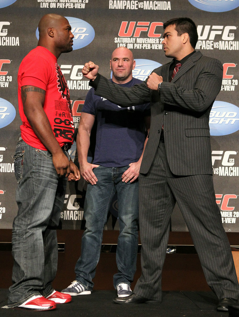 Quinton &quot;Rampage&quot; Jackson (L) and Lyoto &quot;The Dragon&quot; Machida (R) face off as UFC President Dana White looks on at the UFC 123 pre-fight press conference at the MGM Grand Hotel and Casino in Detroit, Michigan on November 17, 2010  (Photo by Josh Hedges/Zuffa LLC/Zuffa LLC via