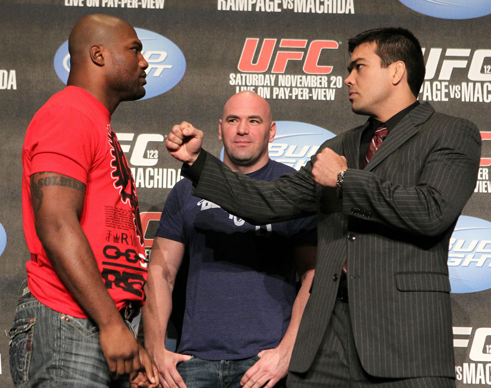 "Quinton ""Rampage"" Jackson (L) and Lyoto ""The Dragon"" Machida (R) face off as UFC President Dana White looks on at the UFC 123 pre-fight press conference at the MGM Grand Hotel and Casino in Detroit, Michigan on November 17, 2010  (Photo by Josh Hedges/Zuffa LLC/Zuffa LLC via"