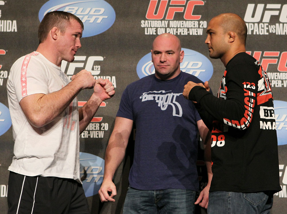 Matt Hughes (L) and BJ Penn (R) face off as UFC President Dana White looks on at the UFC 123 pre-fight press conference at the MGM Grand Hotel and Casino in Detroit, Michigan on November 17, 2010  (Photo by Josh Hedges/Zuffa LLC/Zuffa LLC via Getty Images)