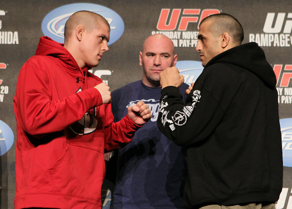 Joe Lauzon (L) and George Sotiropoulos (R) face off as UFC President Dana White looks on at the UFC 123 pre-fight press conference at the MGM Grand Hotel and Casino in Detroit, Michigan on November 17, 2010  (Photo by Josh Hedges/Zuffa LLC/Zuffa LLC via Getty Images)