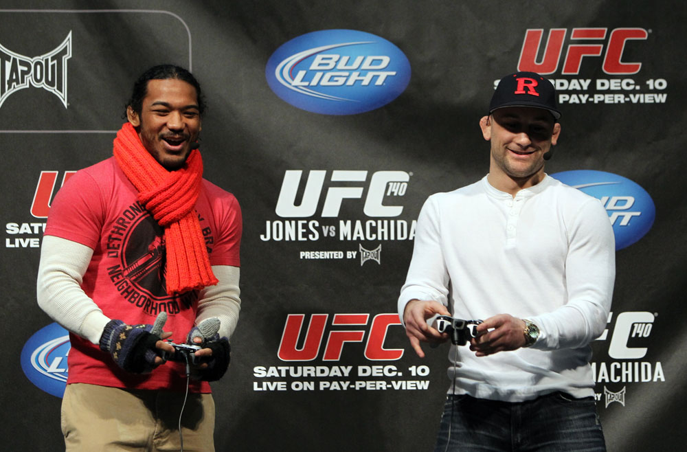 TORONTO, ON - DECEMBER 09:  (R-L) UFC Lightweight Champion Frankie Edgar and challenger Benson Henderson battle each other on the UFC Undisputed 3 videogame before the UFC 140 Official Weigh-in at the Air Canada Centre on December 9, 2011 in Toronto, Canada.  (Photo by Josh Hedges/Zuffa LLC/Zuffa LLC via Getty Images)