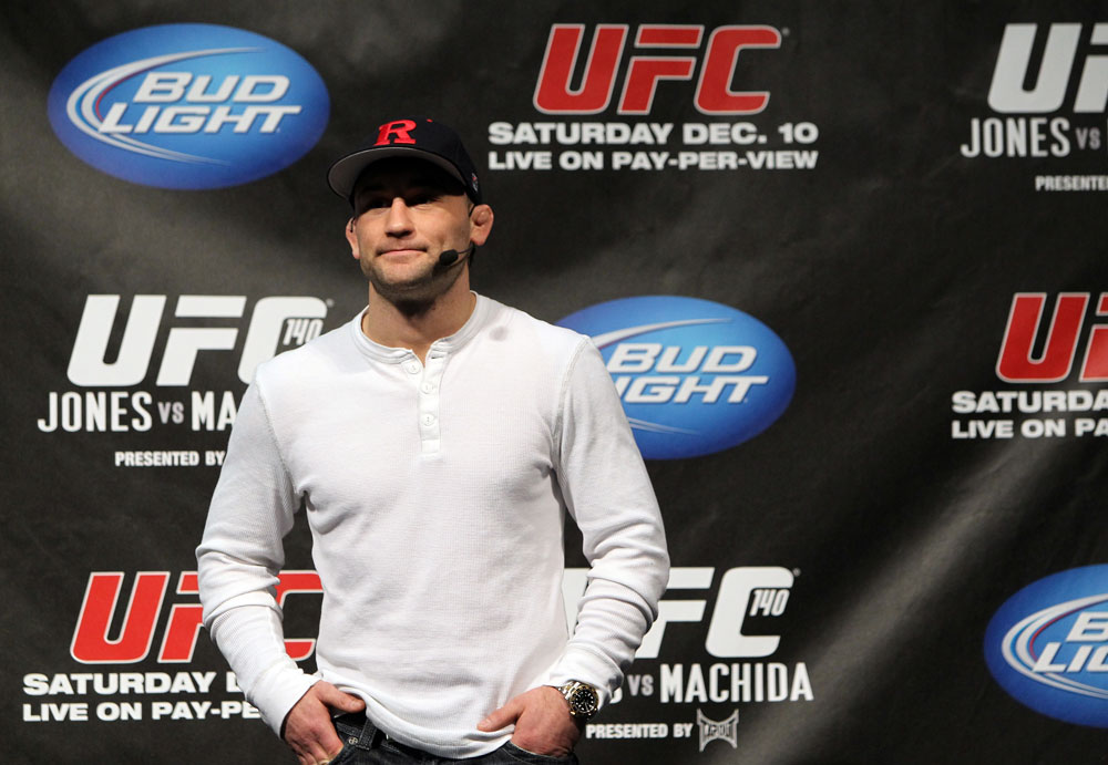 TORONTO, ON - DECEMBER 09:  UFC Lightweight Champion Frankie Edgar stands on stage after defeating Benson Henderson on the UFC Undisputed 3 videogame before the UFC 140 Official Weigh-in at the Air Canada Centre on December 9, 2011 in Toronto, Canada.  (Photo by Josh Hedges/Zuffa LLC/Zuffa LLC via Getty Images)