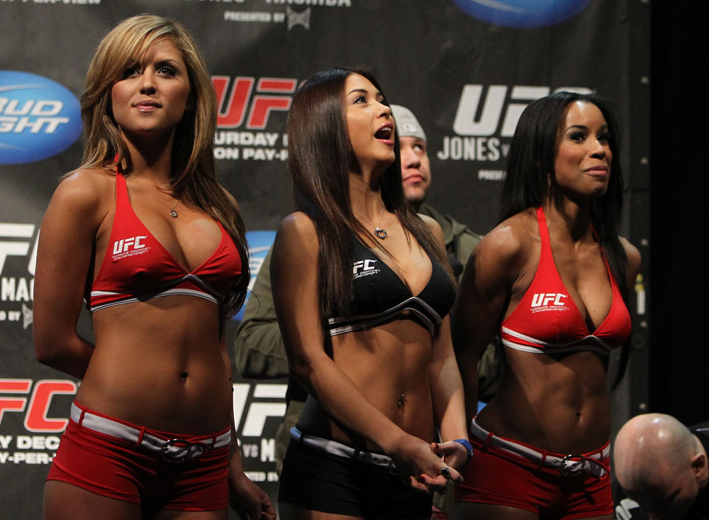 TORONTO, ON - DECEMBER 09:  (L-R) UFC Octagon Girls Brittney Palmer, Arianny Celeste, and Chandella Powell turn their backs to the scale as Mitch Clarke weighs in during the UFC 140 Official Weigh-in at the Air Canada Centre on December 9, 2011 in Toronto, Canada.  (Photo by Josh Hedges/Zuffa LLC/Zuffa LLC via Getty Images)